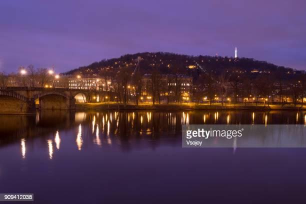 the twinkle lights over the vltava river, prague, czech republic - vsojoy stockfoto's en -beelden