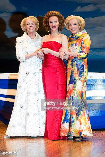 The twins Alice and Ellen Kessler and Sarah Schuetz attend the 'Ich war noch niemals in New York' photocall at Stage Theatre on May 31 2015 in Berlin...