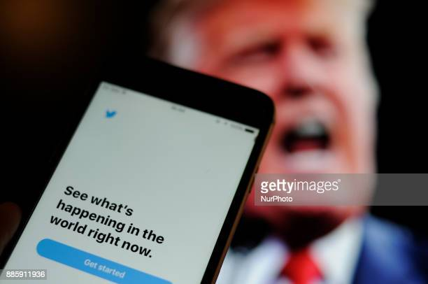The Twitter app is seen with an image of US president Donald Trump in the background in this photo illustration on December 4 2017