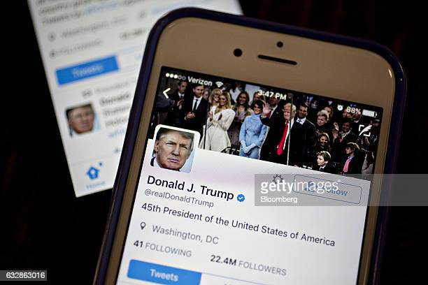 The Twitter Inc accounts of US President Donald Trump @POTUS and @realDoanldTrump are seen on an Apple Inc iPhone arranged for a photograph in...