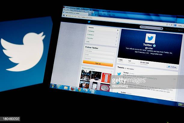 The Twitter Inc logo and homepage are displayed on computer monitors for a photograph in Washington DC US on Friday Sept 13 2013 Twitter Inc's market...