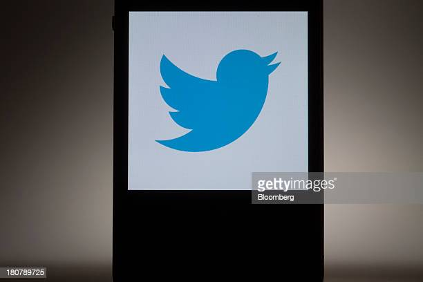 The Twitter Inc logo is displayed on a mobile device for a photograph in New York US on Monday Sept 16 2013 Twitter Inc which announced plans last...