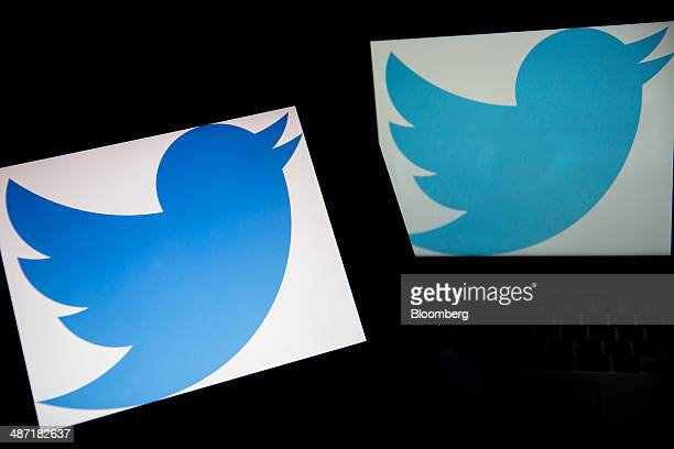 The Twitter Inc logo is displayed on laptop computers in this arranged photograph in Washington DC US on Friday April 25 2014 Twitter Inc is expected...