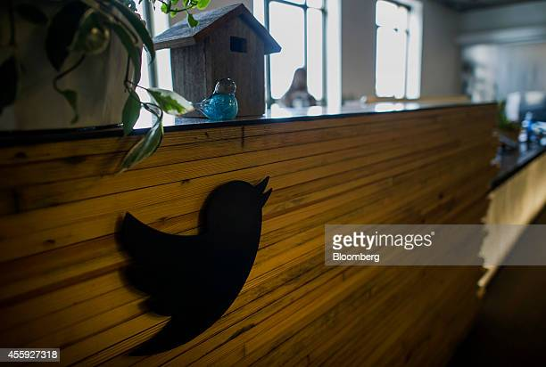 The Twitter Inc logo is seen at the reception area inside the company's headquarters in San Francisco California US on Friday Sept 19 2014 Twitter...