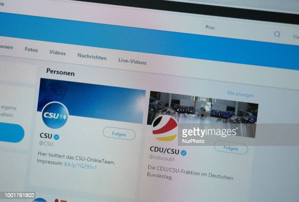 The twitter profile of the Christian Social Union is seen next the profile of the CDU / CSU faction in the German Parliament on a screen