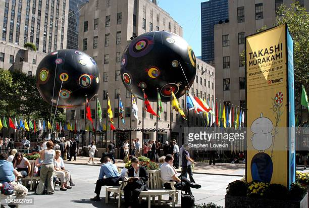 The two 33foot 'eyeball' balloons by Takashi Murakami floating above the ice rink in Rockefeller Plaza