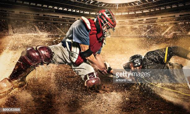 the two caucasian men as baseball players playing against stadium - baseball sport stock pictures, royalty-free photos & images
