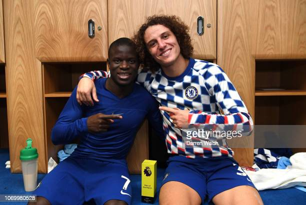 The two Chelsea goal scorers N'golo Kante of Chelsea and David Luiz of Chelsea celebrate victory in the changing room after the Premier League match...