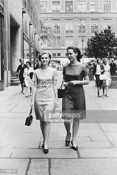 The two daughters of former Vice President Richard Nixon Tricia and Julie carry their purses as they walk along the pavement in Manhattan New York...