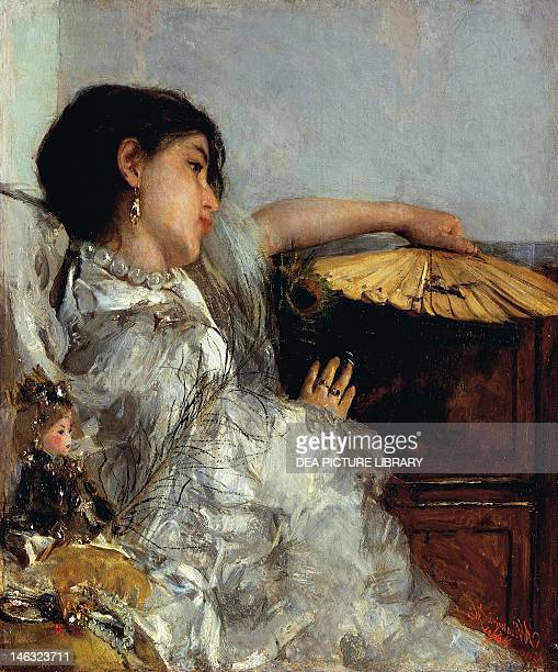 The two dolls or Young or Oriental Girl with Fan by Antonio Mancini oil on canvas 82x71 cm
