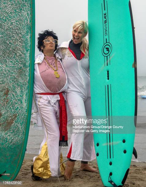 "The two Elvis impersonators ""u2014 Debby Falese, left, and Kristi Ancove, get ready to get all shook up on the surf during Blackies 17th Annual..."