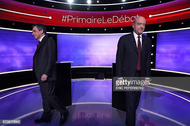 TOPSHOT The two finalists in France's conservative presidential primary Francois Fillon and Alain Juppe leave after posing for photographs prior to...