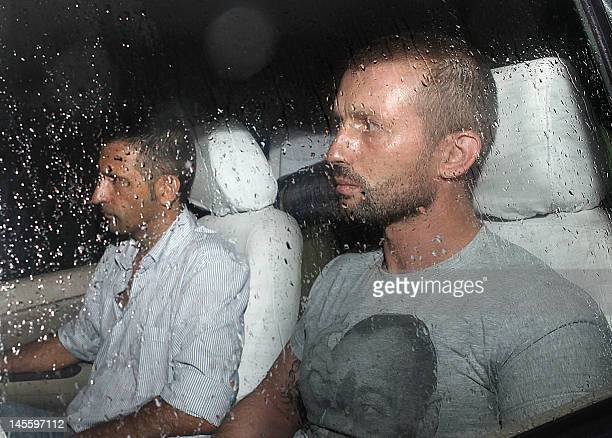 The two Italian marines accused of murdering two Indian fishermen leave after being released following a preliminary hearing on June 1 2012 in a case...