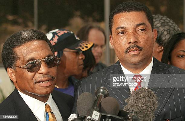 The two lawyers for Donovan Jackson, Joe Hopkins and John Sweeney , talk to reporters during a press conference 10 July 2002 in Los Angeles. The US...