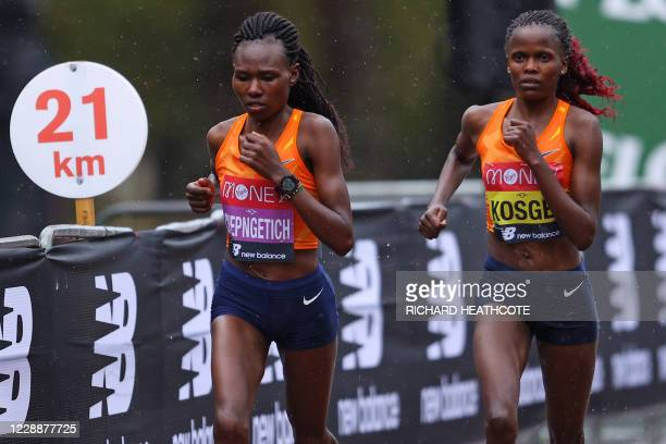 The two leaders Kenya's Ruth Chepngetich and Kenya's Brigid Kosgei compete in the women's race of the 2020 London Marathon in central London on...