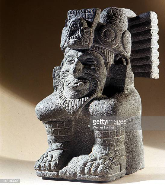 The Two Lord Ometecuhtli who was both male and female and the supreme creative deity in the Aztec Pantheon This seated figure shows him in the form...