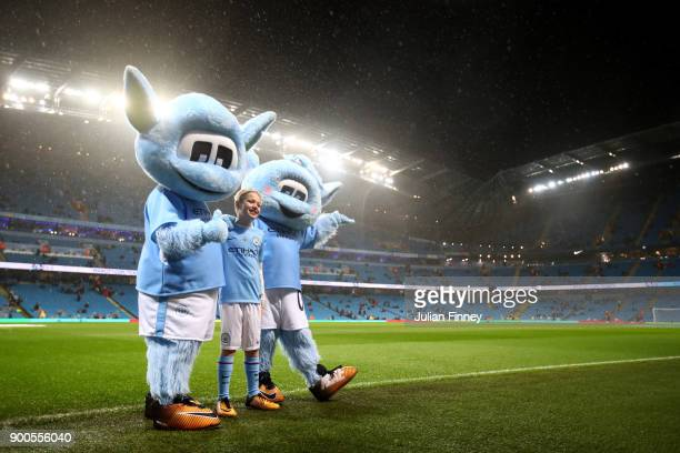 The two Manchester City mascots are seen prior to the Premier League match between Manchester City and Watford at Etihad Stadium on January 2 2018 in...