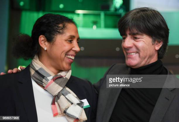 The two national soccer coaches Joachim Loew and Steffi Jones speak at the extraordinary federal conference of the German Football Association at the...