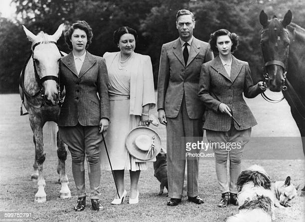 The two princesses Elizabeth left and Margaret Rose right pose with Their Majesties Queen Elizabeth and King George VI before setting off on their...