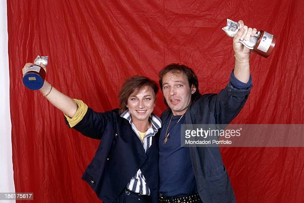 The two rock singers Vasco Rossi and Gianna Nannini smiling on a photo set with a Telegatto in their hands after prize giving ceremony at Vota la...