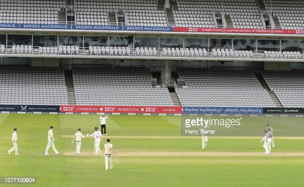 The two side embrace at the end of the match during Day Five of the Bob Willis Trophy Final match between Somerset and Essex at Lord's Cricket Ground...