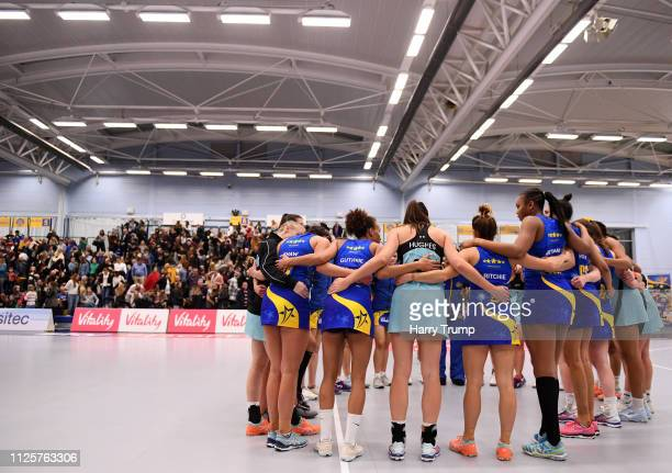 The two sides hold a post match huddle after the Vitality Netball Superleague match between Team Bath and Surrey Storm at the University of Bath on...