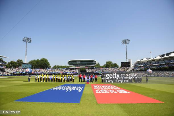 The two sides line up for the national anthems during the Group Stage match of the ICC Cricket World Cup 2019 between New Zealand and Australia at...