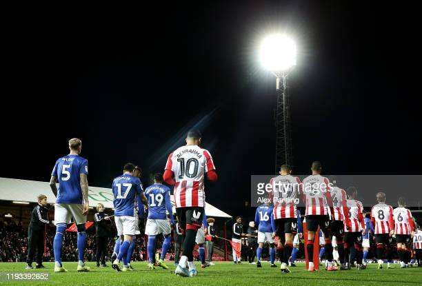 The two sides make their way out during the Sky Bet Championship match between Brentford and Cardiff City at Griffin Park on December 11, 2019 in...