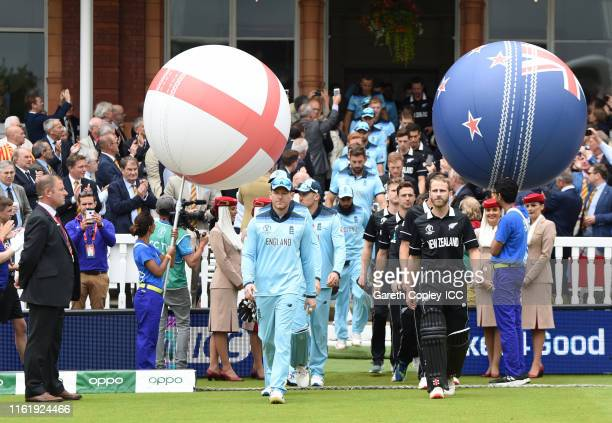The two sides make their way out for the national anthems during the Final of the ICC Cricket World Cup 2019 between New Zealand and England at...