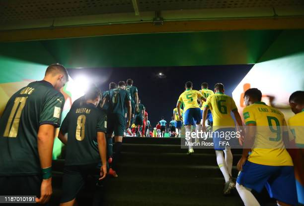 The two sides make their way out for the start during the FIFA U-17 World Cup Quarter Final match between Italy and Brazil at the Estádio Olímpico...