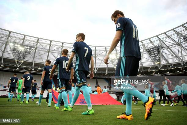 The two sides make their way out onto the pitch prior to the Premier League 2 match between West Ham United and Middlesbrough at London Stadium on...