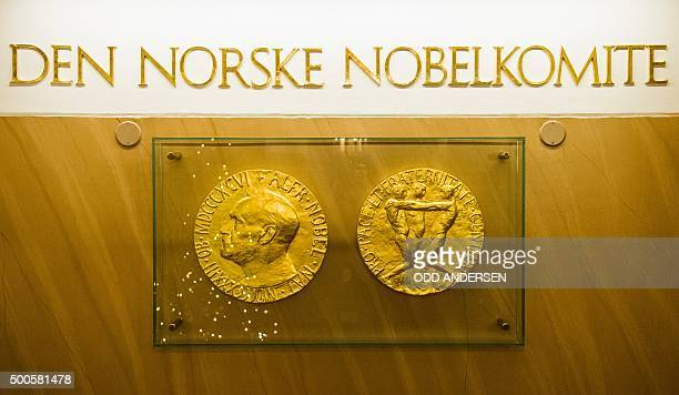 The two sides of the Nobel medal with the profile of Alfred Nobel on one side are seen in the lobby of the Nobel institute in Oslo on December 9 2015...