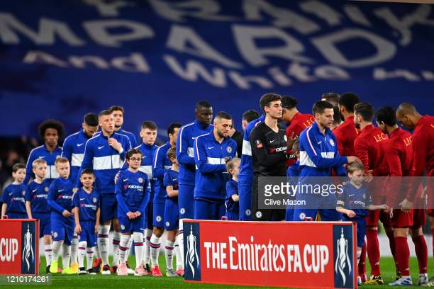 The two sides shake hands prior to the FA Cup Fifth Round match between Chelsea FC and Liverpool FC at Stamford Bridge on March 03 2020 in London...