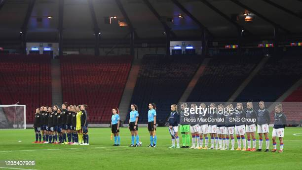 The two sides stand for the national anthems during a FIFA World Cup Qualifier between Scotland and Faroe Islands at Hampden Park on September 21 in...