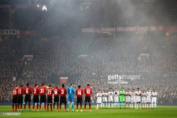 The two sides take part in a minutes applause for former Argentine football player Emiliano Sala during the UEFA Champions League Round of 16 First...