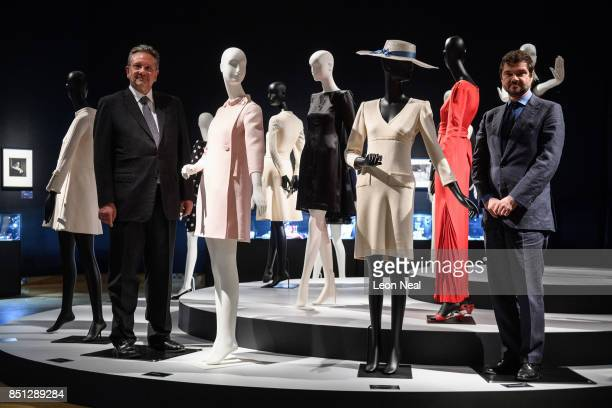 The two sons of Audrey Hepburn Sean Hepburn Ferrer and Luca Dotti pose with a selection of her dresses during a preview of items from the sale of...