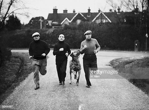 The two sons of Sir Arthur Conan Doyle Denis and Adrian on a run with trainer and former boxer Johnny Brown near their home in Crowborough Sussex...