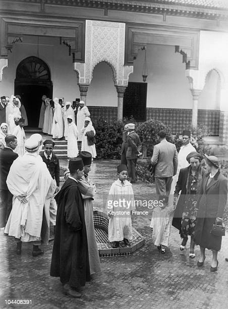 The two sons of the Sultan MOHAMMED V of Morocco HASSAN and ABDALLAH stand in the courtyard of the Mosque of Paris on July 16 1937 during the...