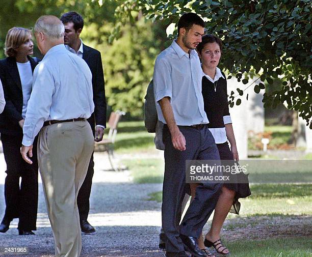 The two sons of the UN envoy to Iraq Sergio Viera De Mello Adrian and Laurent arrive with their girlfriends at the Chappelle of The Kings in Geneva...