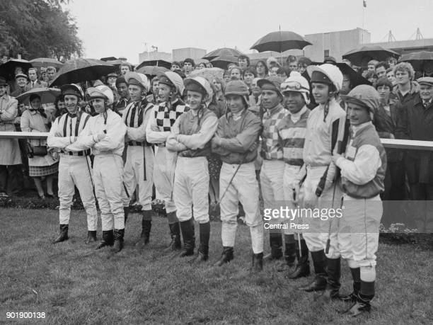 The two teams at the Chivas Regal Trophy a threerace challenge between British and American jockeys at Sandown UK 22nd October 1980 From left to...