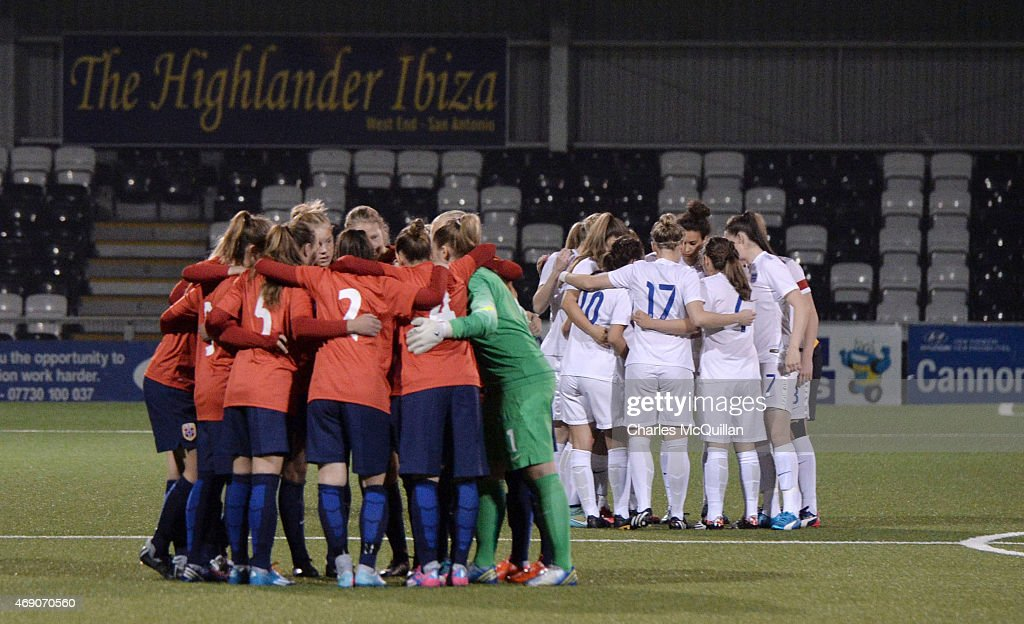 The two teams go into huddles before the retaking of a last minute penalty by Leah Williamson of England from the UEFA U19 Women's Qualifier between England and Norway at Seaview on April 9, 2015 in Belfast, Northern Ireland. The original penalty, taken during the game played on Saturday April 4, 2015, was incorrectly disallowed by the match official and the retaking of the penalty, with both teams in attendance, was ordered by UEFA.