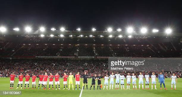The two teams line up ahead of the Carabao Cup Third Round match between Manchester United and West Ham United at Old Trafford on September 22, 2021...