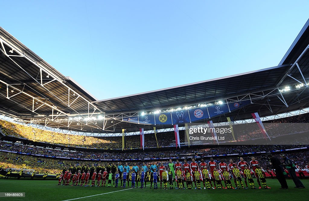 The two teams line up ahead of the UEFA Champions League final match between Borussia Dortmund and FC Bayern Muenchen at Wembley Stadium on May 25, 2013 in London, United Kingdom.