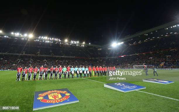 The two teams line up ahead of the UEFA Champions League group A match between Manchester United and SL Benfica at Old Trafford on October 31 2017 in...