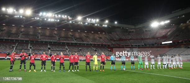 The two teams line up ahead of the UEFA Champions League Group H stage match between Manchester United and RB Leipzig at Old Trafford on October 28...
