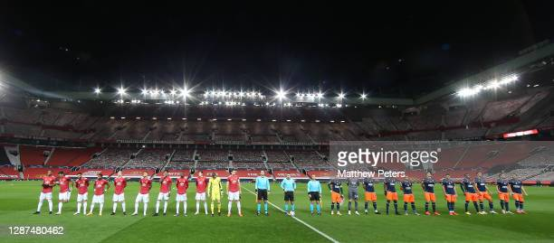 The two teams line up ahead of the UEFA Champions League Group H stage match between Manchester United and İstanbul Basaksehir at Old Trafford on...