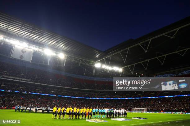 The two teams line up ahead of the UEFA Champions League Group H match between Tottenham Hotspur and Borussia Dortmund at Wembley Stadium on...