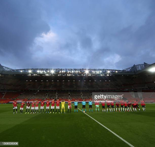 The two teams line up ahead of the UEFA Europa League Round of 16 First Leg match between Manchester United and A.C. Milan at Old Trafford on March...