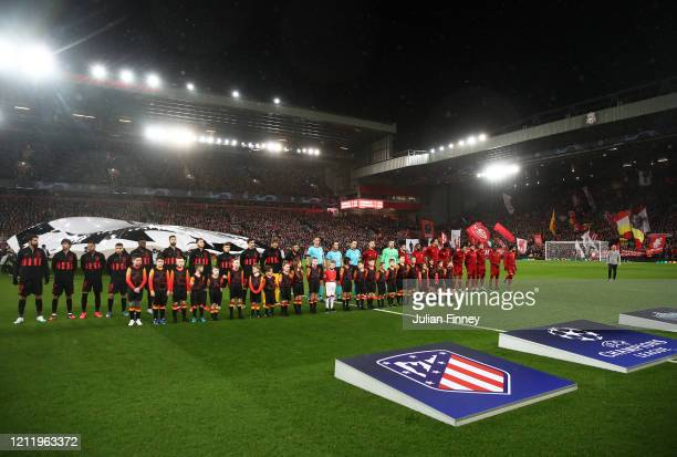 The two teams line up before the UEFA Champions League round of 16 second leg match between Liverpool FC and Atletico Madrid at Anfield on March 11...