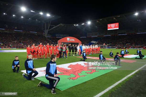 The two teams line up before the UEFA Euro 2020 Qualifier between Wales and Hungary at Cardiff City Stadium on November 19, 2019 in Cardiff, United...